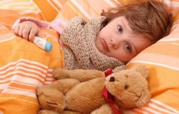 Ребенок заболел и лежит в кровати