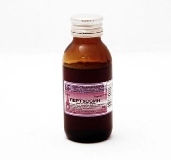 Бутылка темного цвета с сиропом