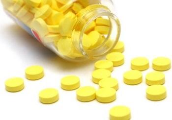 Желтые таблетки в банке